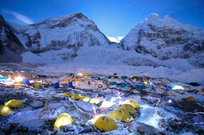 A Scene From Everest Basecamp A busy night in Basecamp as evidenced by trails of headlamps coursing through tents along the Khumbu Glacier. The West Shoulder, Khumbu Icefall, and Nuptse rise behind. Photograph by Jake Norton