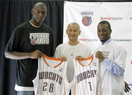 Kemba Walker and Bismack Biyombo with Bobcats GM Rich Cho. Whether they make a difference in what has historically been a terrible franchise is still to be seen. …………………….GO Bobcats