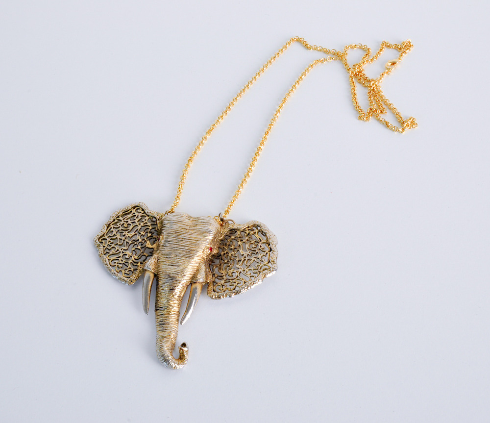 gold elephant trunk pendant
