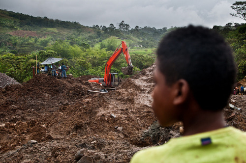 Colombia-9 on Flickr.Via Flickr: Child miner looks over the damage at the Mondomo mining site.