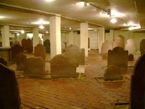 This is the crypt of Center Church on New Haven Green in Connecticut, my home state. It kind of looks like a graveyard, but with bricks instead of grass and four walls and a ceiling instead of fresh air. That's because it used to be a graveyard, or a small portion of one. When they built the Center Church in the early 19th century, they built the church on top of an existing burial ground, creating a crypt beneath the church where part of the old cemetery could be preserved. Here lie 137 identified New Havenites under headstones dating from 1687 to 1812, (including some notables, like Benedict Arnold's first wife), and what are believed to be the remains of about 1,000 unidentified others. The brick floor is a nice touch. You can read more about the crypt and the history of New Haven Green here and here. If you're in the area, you can even visit! Image Source: Wikipedia.