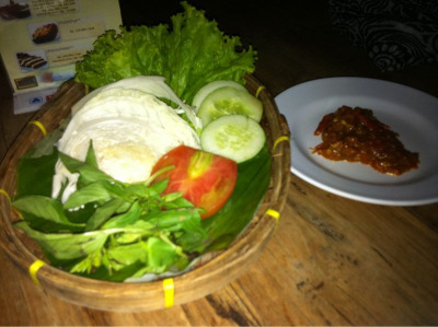 Lalap or Lalapan is raw vegetables which is usually served with Indonesian food as side dish.