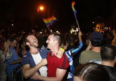 People celebrate after the New York Senate passed a bill legalizing gay marriage in New York June 24, 2011. (image credit: Reuters/Jessica Rinaldi)