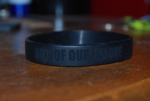 briana-outofourleague:    Out of Our League silicone bracelet (black) A black 202mm x 12mm x 2.2mm (about 8 inches) silicone bracelet with the band's name laser engraved into the side. If you click on the picture, it'll take you to the webstore on our website where you can purchase your own! They're $5 each (which includes the price of the bracelet and postage to get it to you), so if you have any money to spare, it'd be super awesome if you'd be able to buy one.