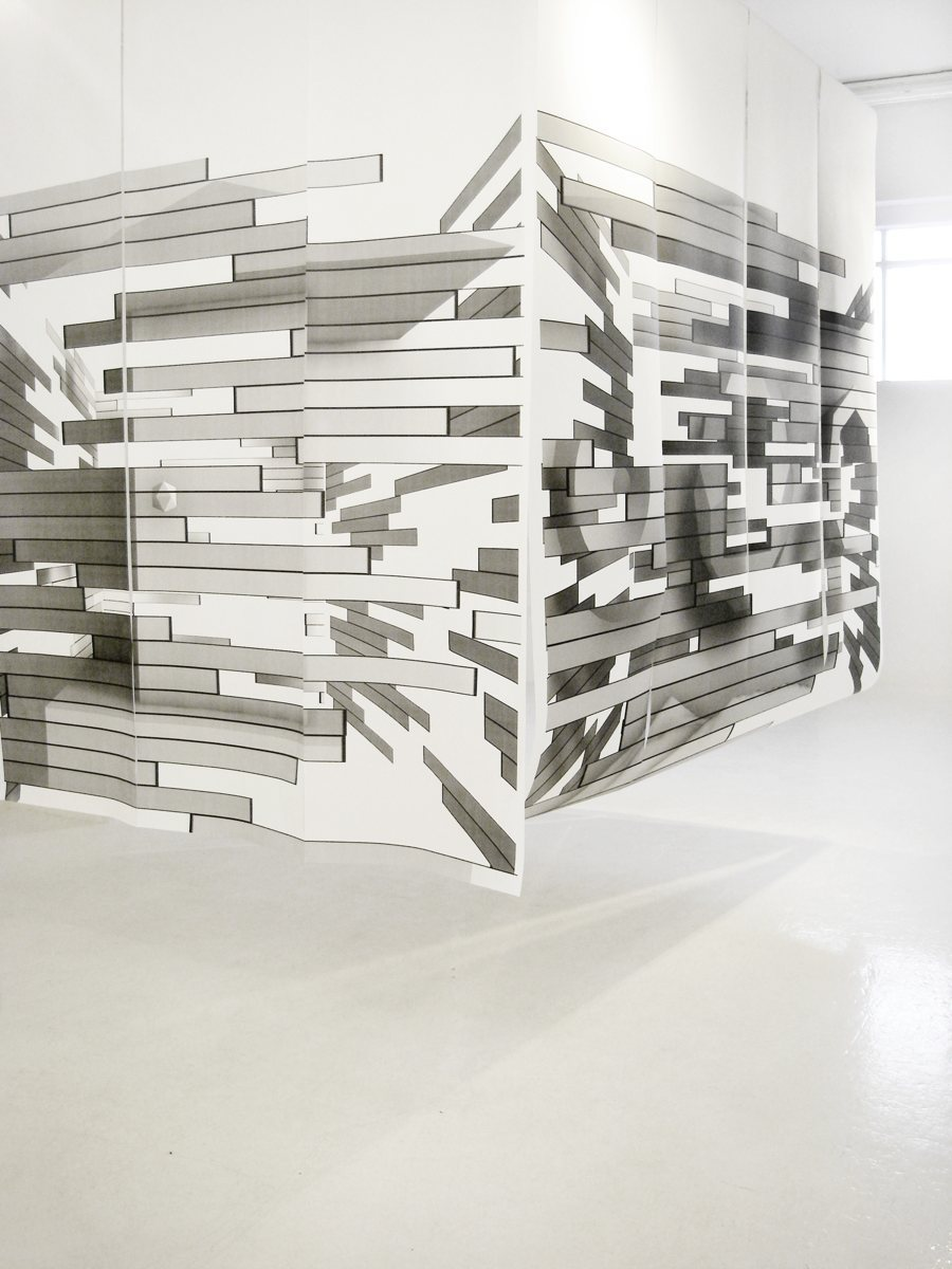Construction Affection is a house made of 2d prints revealing 3d spaces. The house is made of paper which is the building material, which is printed with the graphic of a material, which also reveals a space within the print. We then have a sequence of dimensions in the case of 3d/2d/3d -3d (the house, the box shape), 2d (the material print, wood planks in this case), and 3d again (the space within the print. It's a present loop of realities in different dimensions.