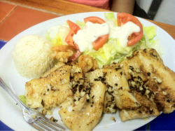Garlic fish. Side of fries, rice & salad