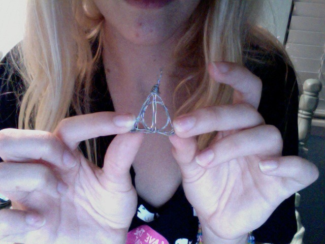 derexxed:  handmade Deathly Hallows trinket, for my boyfriend.  crafted out of metal wire.  might as well just reblog it, i fricken made it haha. i have to do another one and take a better picture.