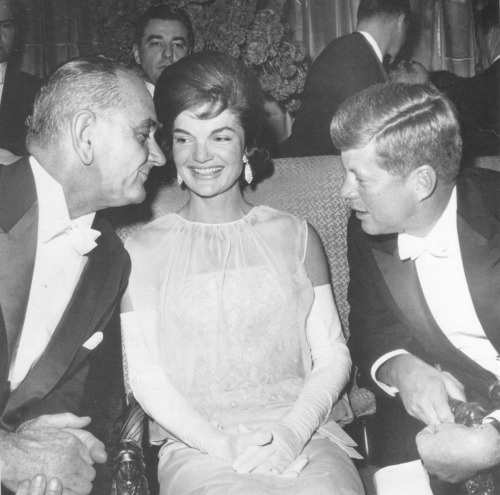 Vice President Lyndon B. Johnson chats with President and Mrs. Kennedy at the Inaugural Ball in the Mayflower Hotel, January 20, 1961.