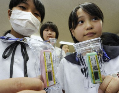 Bag's Take-Away: Was waiting for it to happen: Fukushima Prefecture kids get their own portable dosimeters.  (Any similarity to the iPod, I assume, is strictly coincidental.) (photo: Kyodo News Service caption: Children in the town of Kawamata, Fukushima Prefecture, on June 21, 2011, hold compact dosimeters donated by Kinki University in Osaka Prefecture. The dosimeters are scheduled to be distributed to some 1,500 children and teachers at schools and nurseries in the town from the following day in the wake of radiation leaks at the Fukushima Daiichi power plant in the vicinity stemming from the March 11 quake and tsunami disaster. Part of the town has been designated an evacuation area by the central government.) »See more takes on Japan quake/nuke disaster photos at Bag and  Bag Tumblr.« ————— Topping LIFE.com's 2011 list of Best Photo Blogs, follow us: BagNewsNotes. BAG Twitter. BAG Facebook.