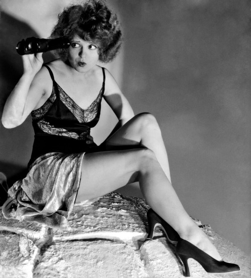 Clara Bow (more photos of Bow) survived a brutal childhood, marred by poverty and her mother's severe mental illness. Bow found comfort in the movies and dreams of stardom, especially after winning a beauty contest that gave her a small movie part as a prize and took of her career. Typifying the flapper girl image, Bow enjoyed a life style beyond her means. She tore around Hollywood in a bright red convertible with pet chows dyed to match her flaming red hair.
