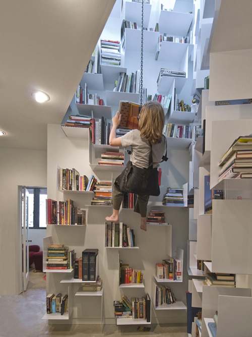 """""""Nights at home spent alone with her books became much more frequent after the swing was installed."""" (Photo: Uncredited;Trout Studios) Note from Inhabitat.com, whose editors submitted this quote/image: """"To be honest though, we can't decide if it's a woman or a little boy with long hair. Either way, we're creeped out."""""""