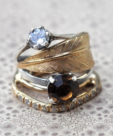 (via Best of Pinterest / feather stacked rings)