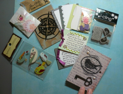 Some of the crafty stuffs in the pockets of my pocket booklet.