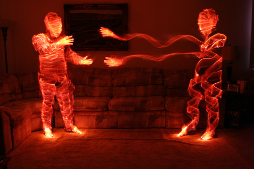 Lightmen by David Schlaich Check out a short tutorial on how to make similar photos at this. Basically it involves glow sticks, long exposures, and some sort of extradimensional alien technology. Has to be. One more: