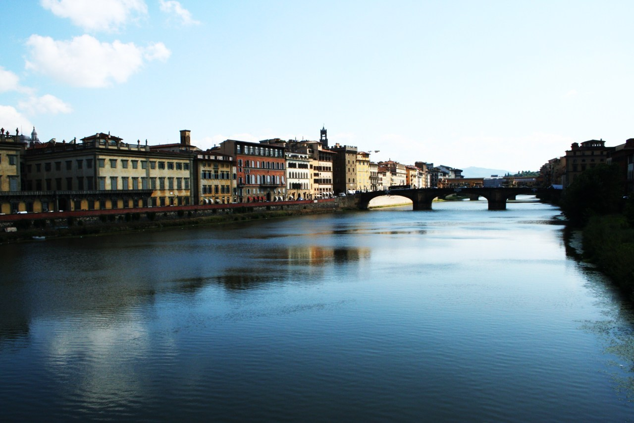 "peoplelikephotos:  Italy, Florence. 2010. Leaving the beautiful and inspiring Siena behind, we stopped shortly in the huge city of Florence. This photo isn't the best of photos but its the only one I've got. Not the first bridge, but the one behind it is the ""Ponte Vecchio"". The Golden Bridge of Florence."