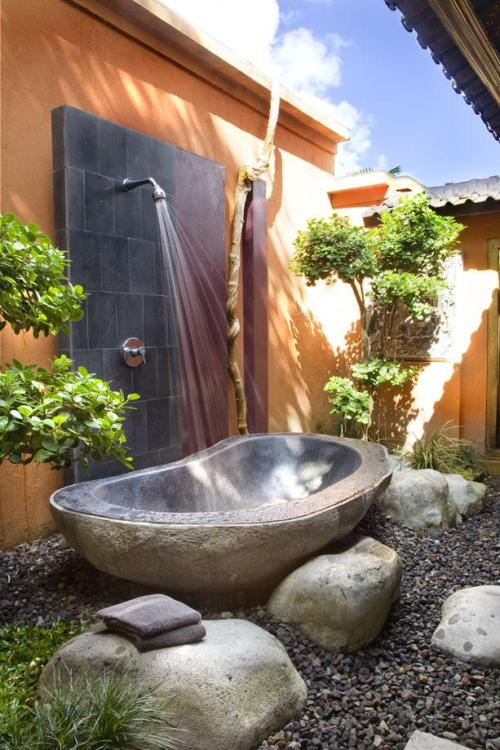 An outdoor shower for an enclosed garden, designed with all the natural ingredients of a mountain waterfall.