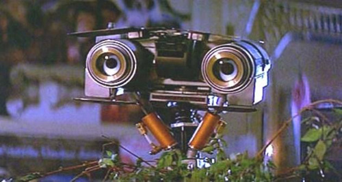"50 Greatest Movie Robots 25. Johnny 5The Robot: Johnny's a nickname. His real moniker is Strategic Artificially Intelligent Nuclear Transport (SAINT) 5, from Short Circuit (1986).Special Features: Yeah, sure, it's impressive that he could blow up the planet if he wanted to. But the fact he can play musical instruments is cooler.Human Qualities? An appreciation for naked Ally Sheedy: ""Nice software!"""