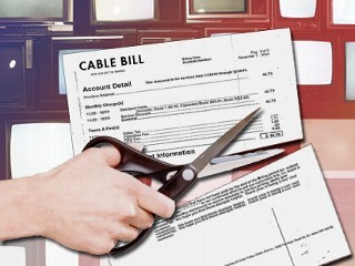 Image of paper cable bill being cut in half with scissors