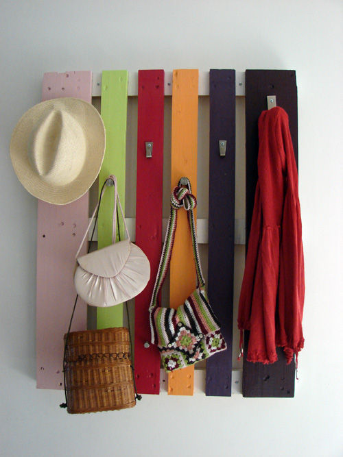 Colorful Coat Rack From A Wood PalletIt's a colorful coat rack that would make your hallway decor more cool and fun! Get tutorial!