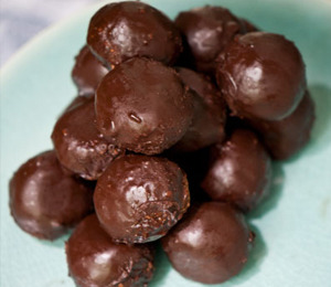 findvegan:  unbaked donut holes dipped in chocolate!