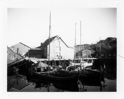 "Fembøring #2 on Flickr.3 traditional Norwegian ""Fembøring"" boats docked at the harbor of Nusfjord in the Lofoten Islands. Polaroid 450 Land Camera using FP100B film."