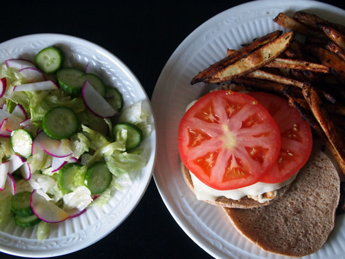 spicy turkey burger topped with havarti & tomato with homemade garlic herb oven fries; garden salad with baby cucumber, radish & mango vinaigrette.