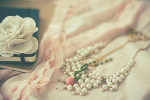 Vintage pearls and diaries.