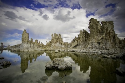 "365 DAYS - 365 PHOTOS - Photo 6, taken October 19, 2008, Mono Lake, California. Just down the street from yesterday's hot springs is Mono Lake, a bizarre lake bordering Yosemite National Park. The alkaline lake is filled with salt formations that come from local hot springs creating bizarre landscapes. The lake was once featured on the back cover of Pink Floyd's Wish You Were here album.    The album's back cover depicts a faceless ""Floyd salesman"", in Thorgerson's words ""selling his soul"" in the desert (shot in the Yuma Desert in California). The absence of wrists and ankles signifies his presence as an ""empty suit"". The inner sleeve shows a veil in a windswept Norfolk grove, and a splash-less diver at Mono Lake—called Monosee on the liner notes—in California (again emphasising the theme of absence). The decision to shroud the cover in black plastic was not popular with the band's US record company, Columbia Records, who insisted that it be changed (they were over-ruled). EMI were however less concerned; the band were reportedly extremely happy with the end product, and when presented with a pre-production mockup, they accepted it with a spontaneous round of applause.  The lake was also written about by Mark Twain frequently. When I lived in the Sierra Nevada,  coming here was always a treat and the location fueled creativity in photography for me. 360 DAYS - 360 PHOTOS is a series of photographs from the archives of jonahkessel.com. Photographs span over eight years and include locations from all around the world. They fall in no particular order, but their own."