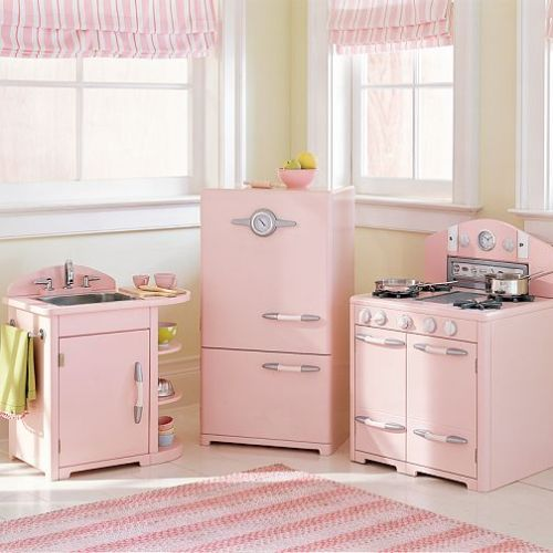 theniftyfifties:  A very pink kitchen from Better Homes and Gardens, 1952.