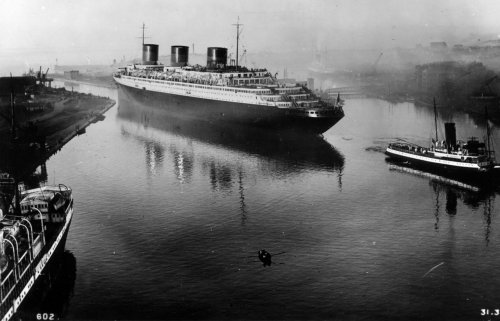 ryantee82:  The SS Normandie in St. Nazaire, on the final stage of fitting out. 1935.