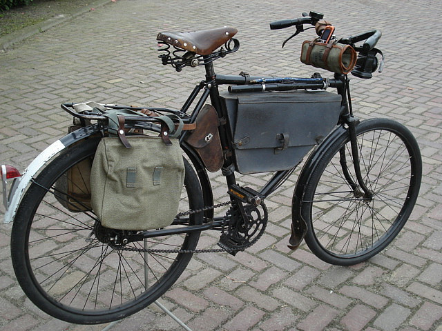So many bags… you could hold everything! revasiwik:  Vintage bicycles for sale by Bikes To Remember on Flickr. Anyone for a bicycle?Via Flickr: Swiss army bicycle all bags on it. Brand: Condor
