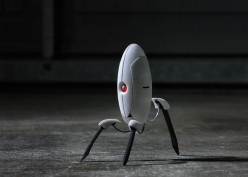 hello by Ѕolo on Flickr.(Work in progress) 1/12 scale Portal Turret Modeled in SolidWorks Printed through Shapeways Pretty satisfied so far, but after this initial prototype I know what needs to change on the model before I order a second. Also I want to try putting a gloss coat on this and paint the legs black like they ought to be (they're paper clips). Before you ask, no. This is not for sale.