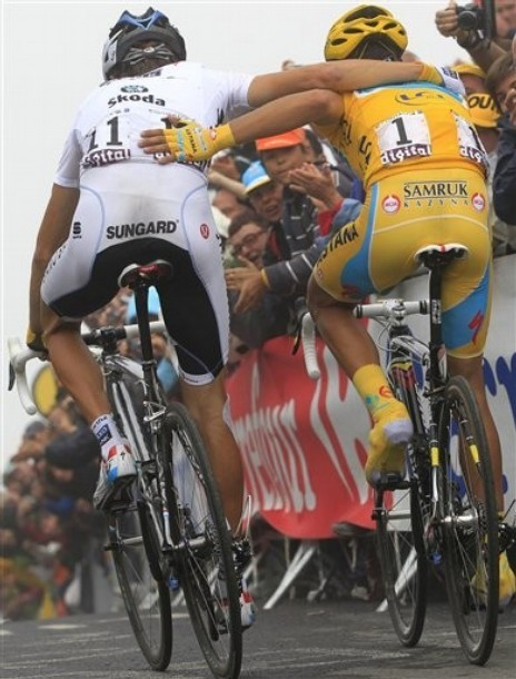 The above Bert and Andy Tourmalet hug was one of the most popular pictures on fuckyeahcycling last year.  We are very much looking forward to this year's race and the memories and pictures it will leave us with.  Tumblr isn't every good at archiving old information so this is inevitably inaccurate but here are a few other pictures that were enjoyed during last year's Tour de France: Artsy wheels shot The brazen mountain sheepgoat Robbie McEwen's wheelie across the finish line on the Tourmalet Schleck bros reunited on the Champs Elysees Marauding sheep on the Col du Soulour Armstrong's battered jersey Honourable mentions to: sad Tyler, combo jersey fashion crime, Menchov is a gooseberry.  Personal favourites: hot days, Sylvain and Jerome bed bouncing. (an excited and anticipatory co-mod Natalie)