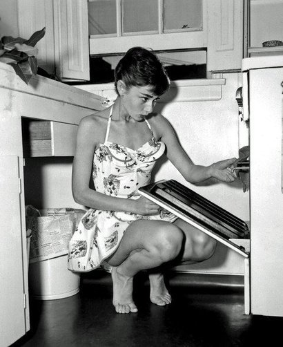 As we're pretty sure she's not about to stick her head in that oven, we're gonna go ahead and say that if she *did* we'd have no qualms slipping that dress right off her and modeling it to the corner. After calling the police, of course randomskeptic: