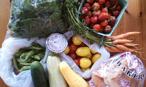 My haul from the Farmers' Market today! I even picked up some things I've never had before - a Mediterranean squash (I forget what he said the name was) and some yellow tomatoes! Roasting some of those veggies right now to throw together with rice and tofu :)