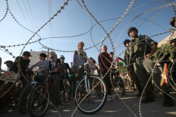 israelfacts:  Palestinian and foreign bikers wait behind barbed wire and a cordon of  Israeli security forces to ride their bicycles under the slogan of  'biking without borders' across a Palestinian road closed off by Israeli  troops to be used by Israeli settlers living illegally in Hebron in the occupied West Bank on June 28, 2011. (Getty Images)   Israeli settlements (as mentioned above) violate international law. The?Fourth Geneva Convention reads:  ?The Occupying Power shall not deport or transfer parts of its own civilian population into the territory it occupies?