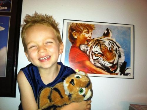 jameshance:  Foreground: @hopegrrrl's real life Calvin with his tiger, Brutus (passed down from his daddy). Background: Real life 'Calvin & Hobbes' print, by me :) Love it!  Too cute for words!