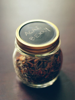 storage jar with lids painted with chalkboard paint.  This way you can easily label and relabel the jars. It's a simple diy  project: get some jars and apply a coat of primer on the lids. Then  apply the chalkboard paint and voila, your jars are ready!