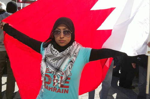 theatlantic:  Exiled and 24: The Young Woman Fighting for Bahrain When Maryam al-Khawaja and I first met in March, in a dingy hospital hallway in Manama, Bahrain's regime had just tear gassed hundreds of its staunchest detractors, shooting them with rubber bullets and live ammunition while they slept and prayed. The dead and wounded were brought to Salmaniya medical center, where their loved ones were met by an energetic girl in jeans and a head scarf, hopping from floor to floor directing foot traffic, doling out information to worried families, and escorting aid workers. Around 3 a.m., with the screams of a grieving mother echoing down the corridor, Maryam delivered a denunciation indictment of the U.S.'s silence on what was going on around her, calling Secretary of State Hillary Clinton's criticism of the regime a mere wrist slap. By May, she had found a bigger audience, having left Bahrain for the U.S. and Europe, her anecdotes and big brown eyes humanizing Bahrain's faltering opposition for a West that did not fully understand it. From Brown University to the Oslo Freedom Forum to Voice of America, she preached the gospel that had been violently muted on Manama's streets — the regime, she repeated, was doing grievous things, and the U.S. and its allies needed to step up their rhetoric. Last week, her work took on a new urgency, when father Abdulhadi al-Khawaja, the country's best-known opposition activist, was marched into a closed-door military tribunal and sentenced to life in prison for anti-government propaganda. That a 24-year-old girl has become the face of one of the most repressed Arab Spring revolutions comes as a surprise only to those who don't know her lineage. Maryam's was born in Denmark to then-exiled Abdulhadi and his wife, Khadija, who had been banned from Bahrain in the mid-1980s. They lived in Denmark until returning to Manama in 2001, as soon as they were allowed re-entry. Maryam was 14 Read more at The Atlantic