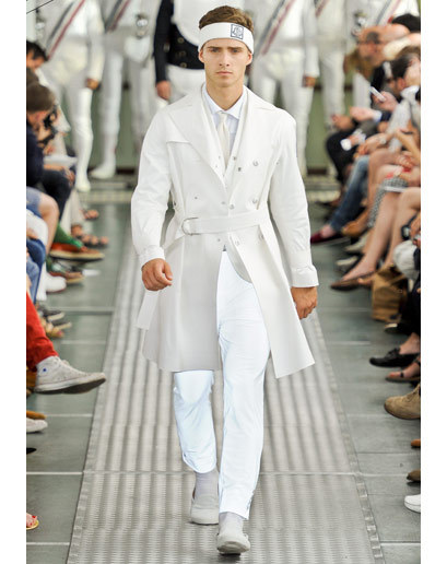 "Good Vibes: Moncler Gamme Bleu Spring 2012 The Vibe for Spring 2012: It's not your first rodeo, so let's skip to the part where we tell you how ""BIG!"" and ""GRAND!"" a Thom Browne-helmed Moncler show is and get right to what you want to know—what awesome sport he's used for inspiration this time around: The word's fencing. As faceless, uniformed men stood en garde, a series of theatrical creations—forward-thinking foil suits, cropped-in close protective gear, and Dark Lord mesh capes—punctuated the real stars of the runway, things like sharply tailored gray plaid suits, lightweight white trenches; and for the guys with the guts to pull 'em off, those Browne-ian striped banana hammocks weren't for show either. See GQ's entire Spring 2012 recap or check out the Moncler Gamme Bleu Spring 2012 collection."