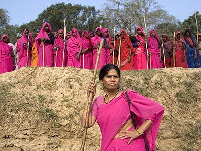 "The founder of the gulabis is the fearless Sampat Pal  Devi, 40, who was married off at the age of 12 to an ice-cream vendor  and had the first of her five children at 15. The gulabis, whose members  say they are a ""gang for justice,"" started in 2006 as a sisterhood of  sorts that looked out for victims of domestic abuse, a problem the  United Nations estimates affects two in three married Indian women.  Named after their hot-pink sari uniforms, the gang paid visits to  abusive husbands and demanded they stop the beatings. When obstinate men  refused to listen, the gulabis would return with large bamboo sticks  called laathis and ""persuade"" them to change their ways. ""When I go  around with a stick, it's to make men fear me. I don't always use it,  but it helps change the mind of men who think they are more powerful  than me"" says Pal. She has assumed the rank of commander in chief and  has appointed district commanders across seven districts in Bundelkhand  to help coordinate the gang's efforts. Pal's group now has more than 20,000 members, and the number is growing."