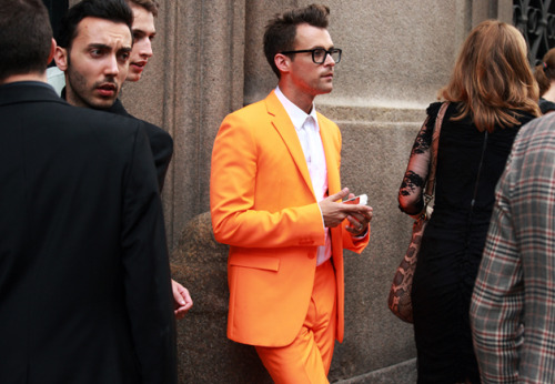 The Street Style Power Rankings: Fashion Week As captured by STREETFSN's Hyunbeon Nam, we rank the 10 men who killed it on the streets of Milan and Paris. Name: Brad Goreski Occupation: Stylist Location: Milan The Signature: Goreski is fearless and daring. His high-toned look, with chunky glasses and affinity for bowties, is classic prep meets breathtaking modernity. The Clincher: The tangerine Jil Sander suit is a grabber, and exactly the kind of move only Goreski could pull off. But it's the buttoned-up shirt beneath it that cinches his personal style.