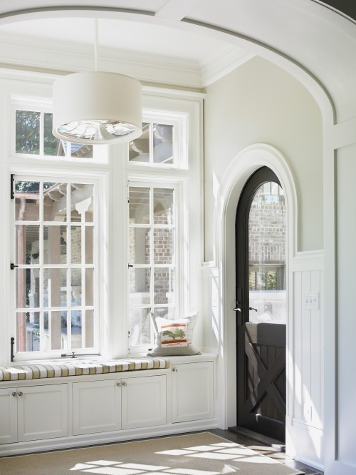myidealhome:  window seat   Yes, and… door - black, farm-style, in arched doorway, window decorative molding striped fabric wide, thick arch windows storage under seat high ceilings bright, airy, fresh feeling