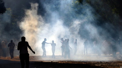 For a second day Egyptian protestors and police clash over the pace of reform. Via the New York Times:  The clashes began Tuesday evening when the police refused to allow a crowd of people to enter a central theater for an event commemorating protesters killed during the 18-day revolution in January. Many in the crowd said they were relatives of those who died and fought with the police to gain entry. The police responded by attacking the crowd, until they reached the square. There, thousands of people, outraged at hearing of the harsh police action, joined in the clashes, which lasted into the night.  Photo: BBC Day in Pictures.