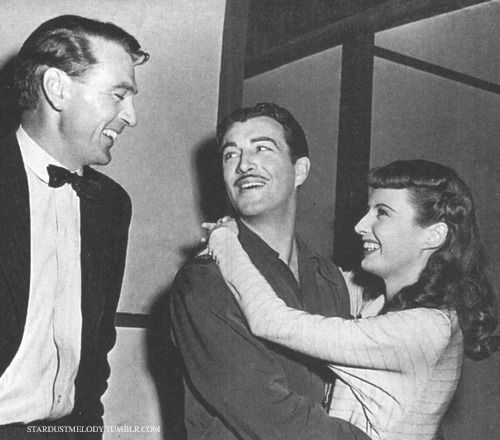 "stardustmelody:  Robert Taylor visiting Barbara Stanwyck and Gary Cooper on the set of ""Ball of Fire"" (1941)."