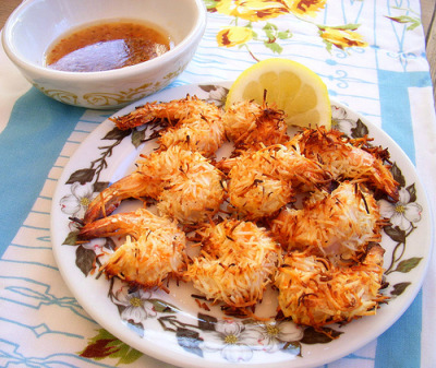 delishytown:  Baked Coconut Shrimp (by Snappy Shop) I made this last September, but it seems like a good appetizer to bring to a BBQ this 4th of July weekend. So I'm reblogging it.   Baked Coconut Shrimp with Apricot Sesame Dipping Sauce This is really easy! and, since it's baked, it's good for you. Hooray! My favorite combo, delicious and good for me! Pre-heat oven to 400. In a shallow bowl combine 1 cup unsweetened, flaked coconutwith a bit of salt and pepper. In another shallow bowl, scramble 2 eggs with a pinch of garlic powder and a pinch of smoked paprika. Put 1/2 cup rice flour in a 3rd bowl. Dredge some peeled & de-veined shrimp in the rice flour, dip in the egg wash, and then coat with the flaked coconut.  Bake at 400 for 10 to 15 minutes till cooked through. Serve with Apricot Sesame dipping sauce.  For the Apricot Sesame Dipping Sauce: Combine 2 tablespoons apricot jelly, the zest and juice of 1 lime, 1 tablespoon toasted sesame seeds, 1 tablespoon soy sauce, 1/4 tsp grated ginger, freshly grated black pepper, 1/8 tsp red chili flakes, 1 tablespoon rice wine vinegar, and 1 tablespoon sesame oil. Enjoy!