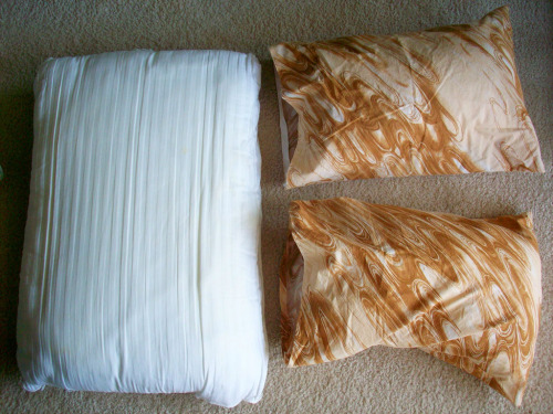 Upcycle an old pillow into two small camping pillows! Tutorial by Turning a House into a Home.