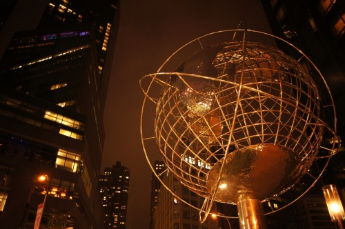 "nythroughthelens:  The Globe in front of Trump Tower. Columbus Circle. Upper West Side, New York City. Buy ""The Globe at Columbus Circle"" Posters and Prints here, View my store, email me, or ask for help. I love the huge globe that sits outside of Trump Tower near Columbus Circle. There is something vaguely old-school futuristic about it. Perhaps that is because I grew up relatively close to  the Unisphere in Flushing here in New York City that I have these sorts of associations. The Flushing Unisphere was designed specifically to celebrate the beginning of the space age, representing a theme of ""global interdependence"".  I am not quite sure that this particular globe has such a lofty theme but it's an interesting association, nonetheless."