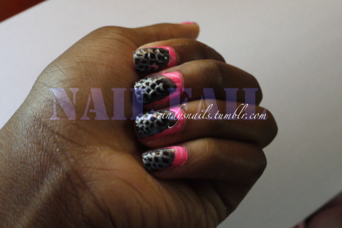 "A few days ago, I was doing my nails. I wanted to do something neon and zebra print, since I had been avoiding those two things for so long. Things were going great, and then I thought ""It would be awesome if I made it look like another print was ripping through the zebra print!"" So I tried it. You know that phrase that goes ""If it's not broken, don't fix it?"" I just kept trying and trying, and I ended up with a nail fail, which is above. This has inspired me to post many more of my nail fails."