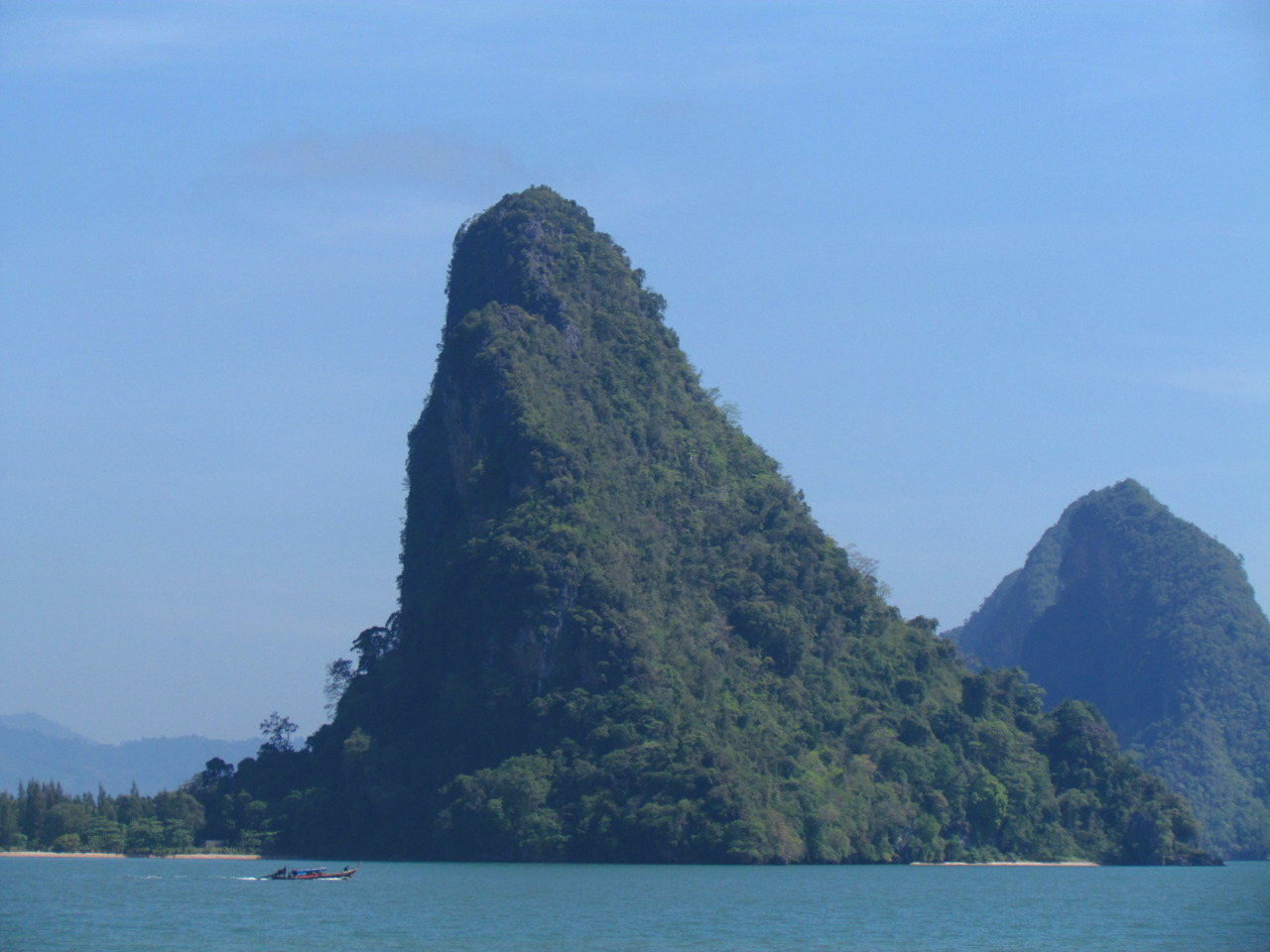 April 2011. An island of the Phang Nga island chain. Ao Phang Nga National Park, Phang Nga, Thailand.